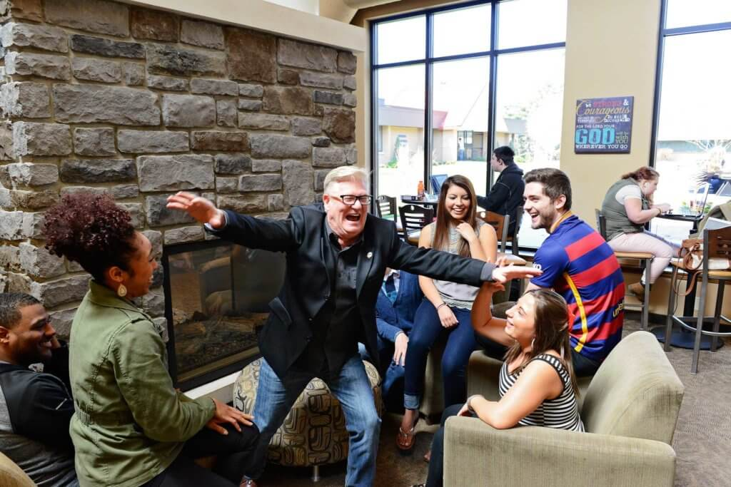 Students with a professor all laughing