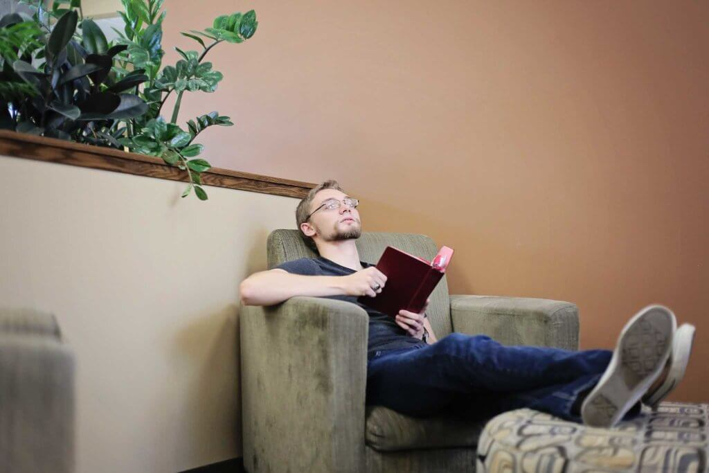 Student sitting with a bible