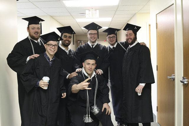 Group of male graduates