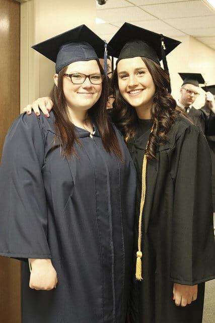 two female grads
