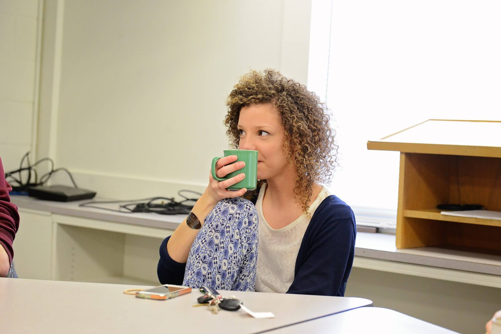 Girl drinking coffee at desk