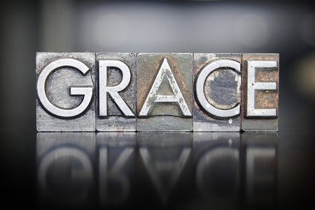 the word grace written in vintage letterpre