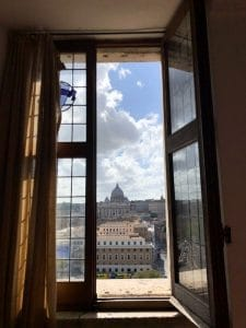 Beautiful architecture of Rome out of a window.